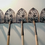 Gardening Tools Contrasted with Intricate Lace Patterns!